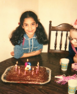 8-year-old me with a big chocolate birthday cake, of course.